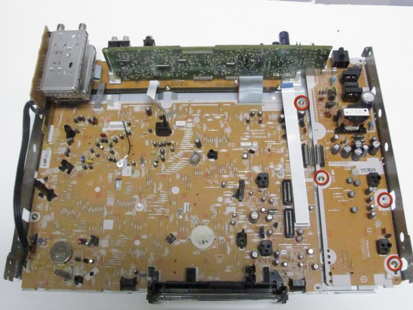 Using a phillips head screwdriver, remove the thirteen screws that shown in images 1-3.