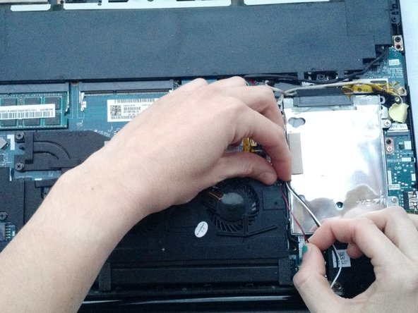 Image 3/3: Carefully unhook each grouping from the small black tabs on the fan