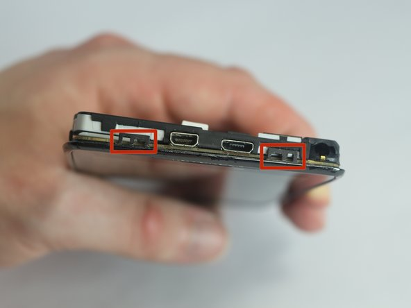 There are four clips that must be released at the top and sides of the phone before the Antenna/Headphone Jack can come completely off.