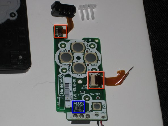 Remove the battery board and LED assembly, and flip them over.