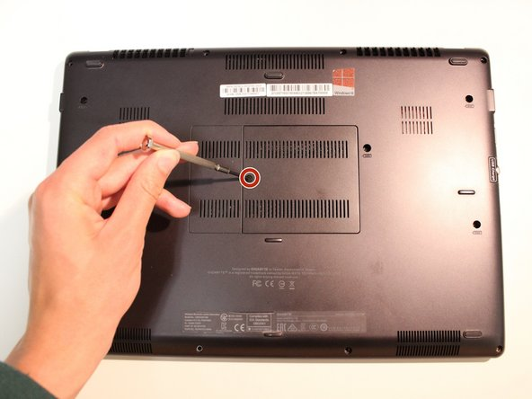 Unscrew the single 9.8mm screw on the underside of the laptop using a #0 screwdriver.