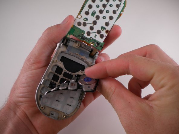 Use an iPod Opening Tool to lift up on the keypad and pull it out.