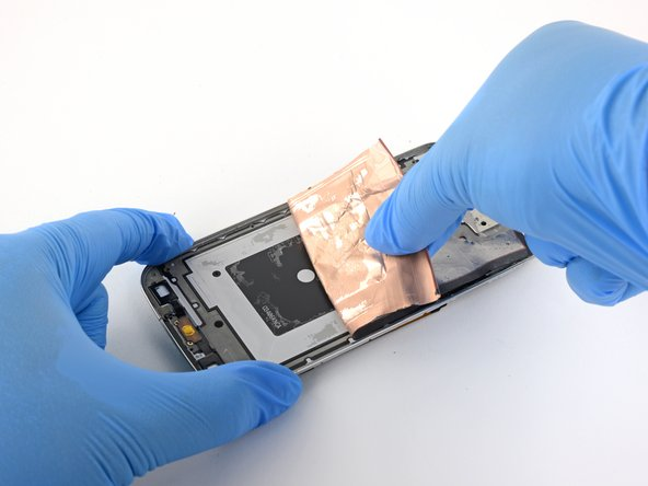 Grab the foil liner underneath the LCD and peel it away from the case.