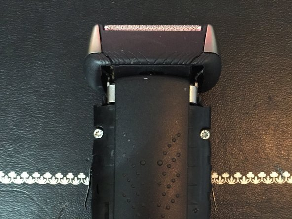 Remove the 4 screws that are now exposed on the back of the shaver. You will need a T9 hex screw driver.