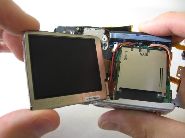 BEWARE: The LCD screen is attached to the logic board by two wires at the bottom.