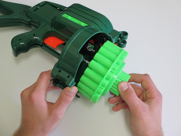 Carefully spread apart the two halves of the gun, and lift out the ammo drum.