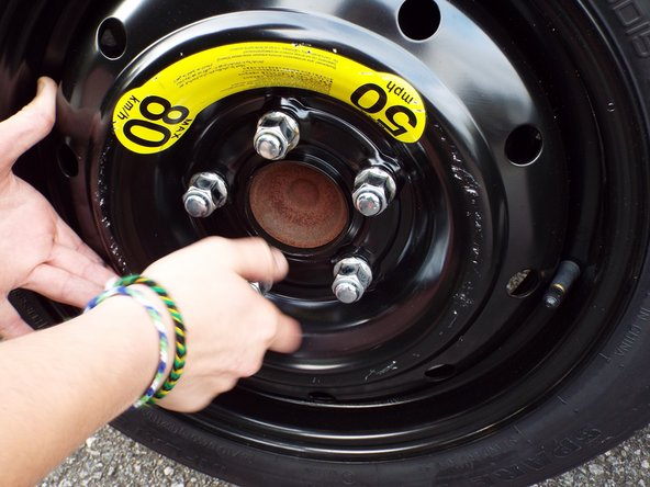 Hand tighten lug nuts (the 1, 3 and 5 positions first) until secure.