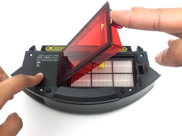 Lift the red plastic cover to access the filter.