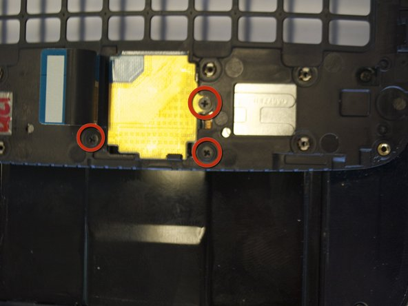 Remove the 3 screws holding down the flex cable.