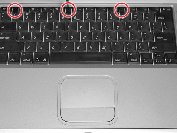 Image 1/1: Turn the keyboard locking screw so that it is parallel to the space bar.