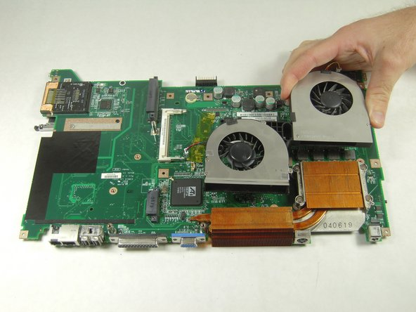 Image 1/1: Lift the fans up to remove them from the motherboard.