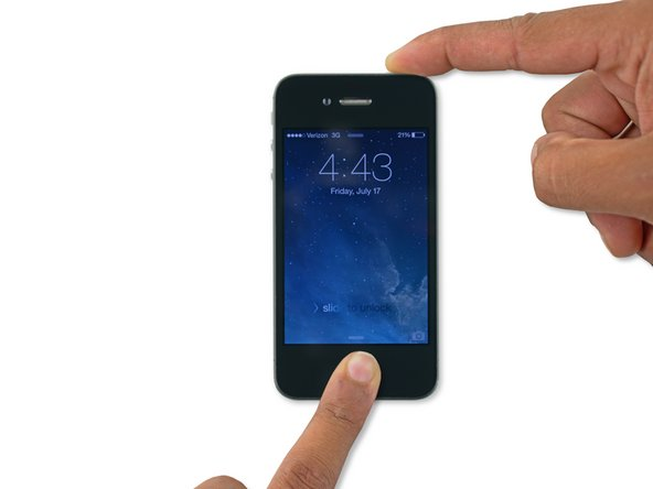 While holding the Home button, press and hold the Sleep/Wake button.