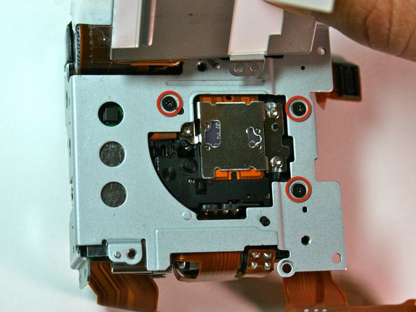Remove the three (3.1mm) black screws that were behind the screen and battery box.