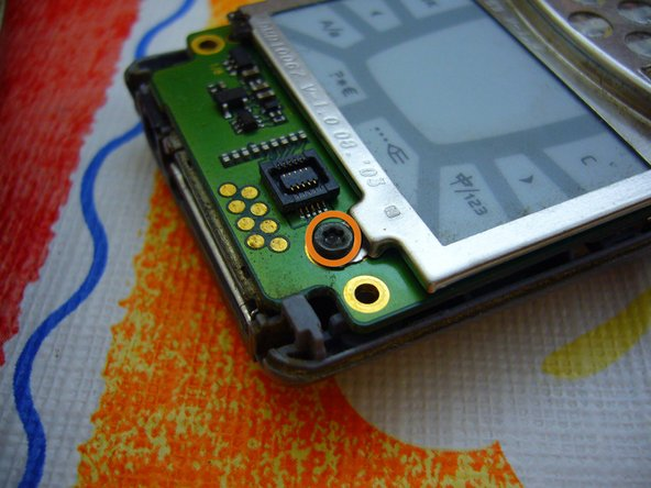 Remove 5 trox screws that are holding the screen and the touch pad.