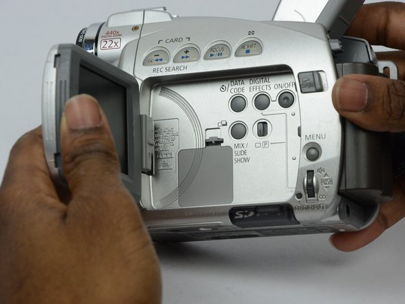 Open the LCD screen to expose the compartment where the LCD battery is held.