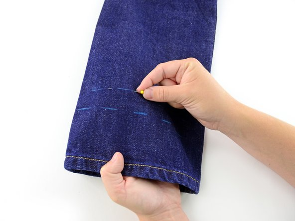 Image 1/3: Be sure to only catch one layer of the jeans, as you don't want to pin the pant leg shut!