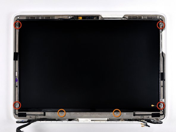 Remove following six screws securing the LCD to the rear display bezel: