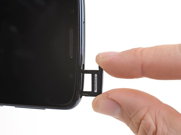 Remove the SIM card tray.