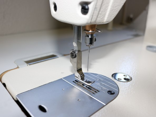 Use the screwdriver to assemble the new  presser foot.