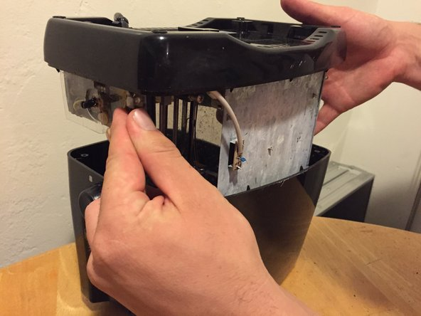 Pull the bottom of the toaster straight out of the top shell.