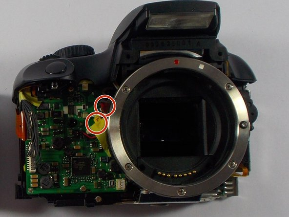 Remove the cable heads attached on the front side of the camera next to the lens mount.