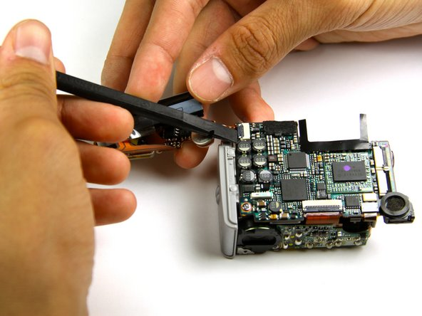 Image 1/2: Gently remove the ribbon cable from the rest of the camera.