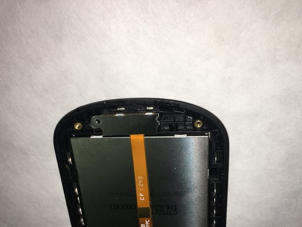 You will see an orange electronic ribbon cable running from the green board at the bottom of the phone, over the back of the screen and finally attached to a metal cover that hides the ear speaker.
