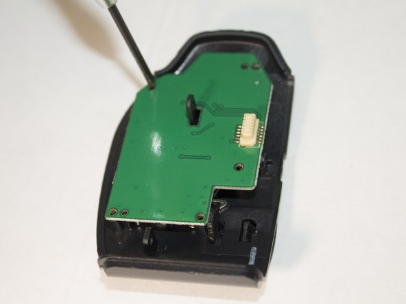 Image 2/2: Remove the three 4 mm Phillips #1 screws holding the circuit board in place.