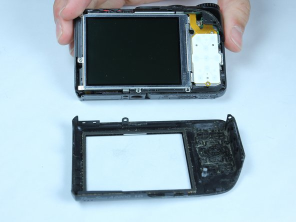 Once there is enough separation between the back cover and the frame, remove the back cover for replacement.