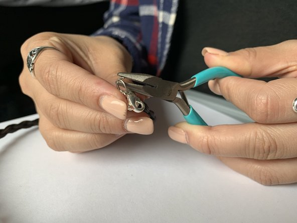 Going from the top, squeeze the jump ring together using the pliers.