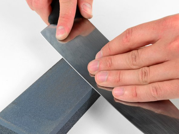 Repeat the process which is detailed in the previous steps to uniformly sharpen both sides of the blade with the fine grit stone.