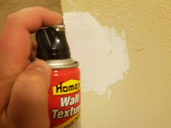 Spray aerosol wall texture over the leveled patch in a quick fluid motion from one side to another.