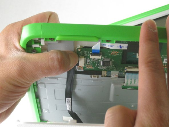 Unplug the cable from the mouse buttons controller to completely remove the lower frame from the device.