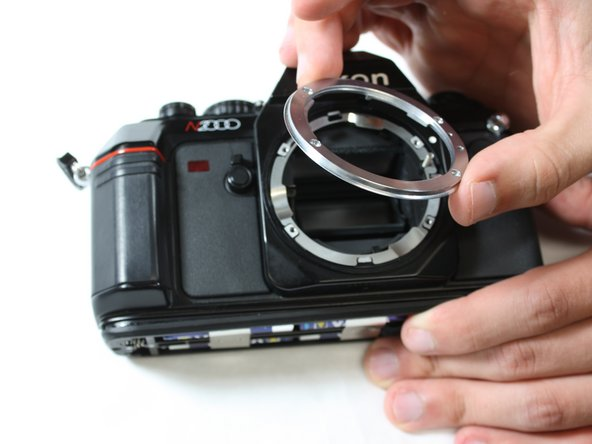 Remove lens mount from the camera.