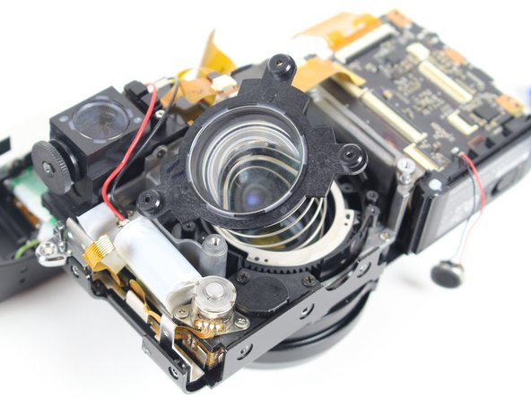 Remove the spring and the lens by gently lifting both the components upwards.