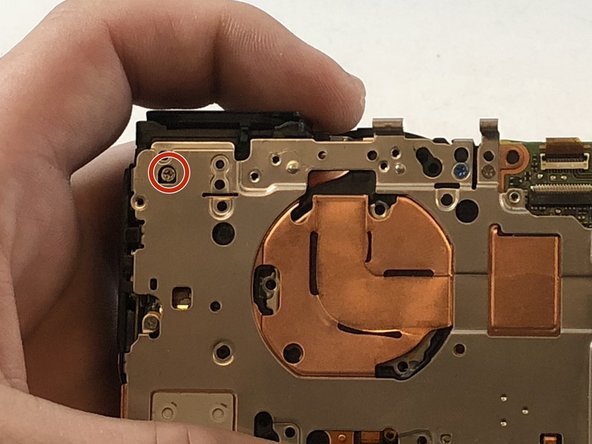 Remove the 2 mm Phillips #000 screw underneath the top plate.