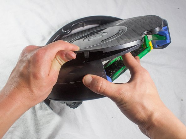 Continue around the outside of the Roomba, pulling up on the faceplate to free all of the outer friction locks.