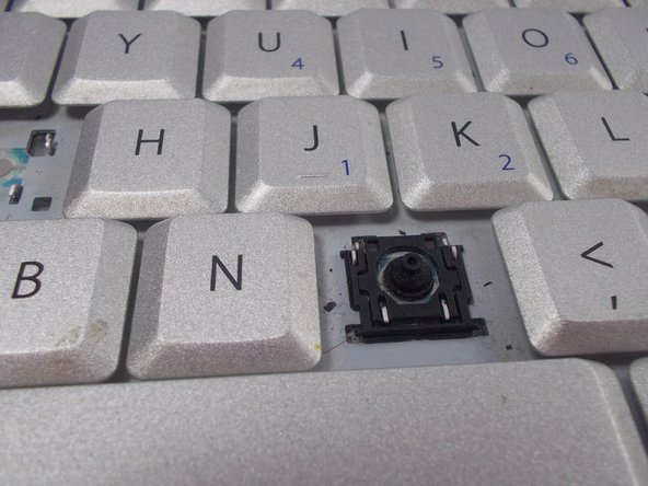 To insert new key, place it directly centered over the rubber nipple and press down firmly.