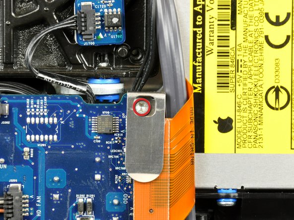 Remove the 7 mm T10 Torx screw securing the optical drive flex cable mounting bracket to the logic board.
