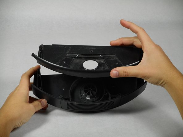 Remove the casing that surrounds the fan by pulling it straight up.