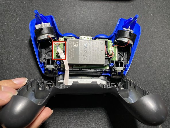 Unplug the ribbon cable to disconnect the touchpad from the controller itself.