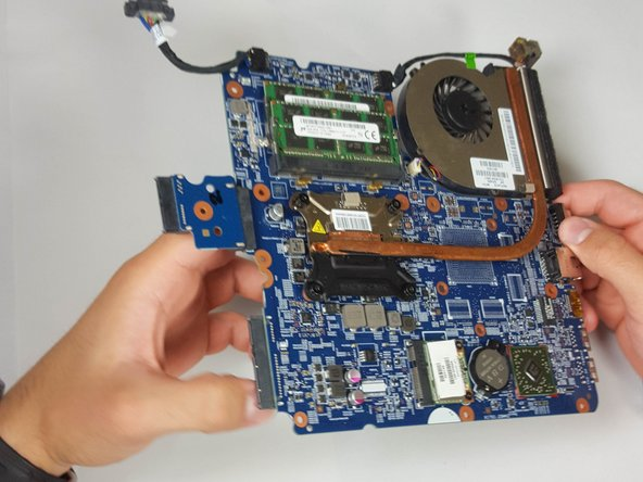 "Turn the motherboard over and lay it flat so that the copper ""L"" is visible."