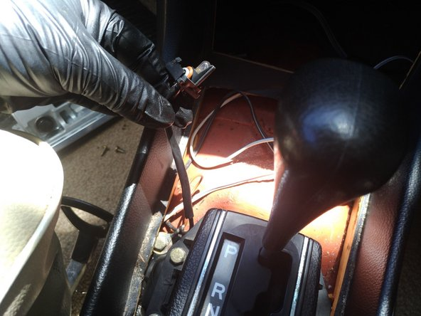 When you're re-installing it, you simply line up the V symbol on the shifter housing with the V symbol on the lamp holder