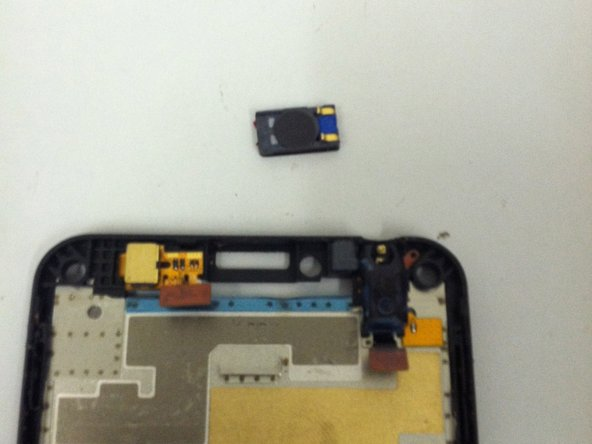 Image 2/2: Be sure to note the orientation of the replacement speaker when you reassemble the device