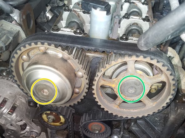 After removing the timing bar, while holding the camshaft with the proper wrench, torque the intake cam to 120 Nm