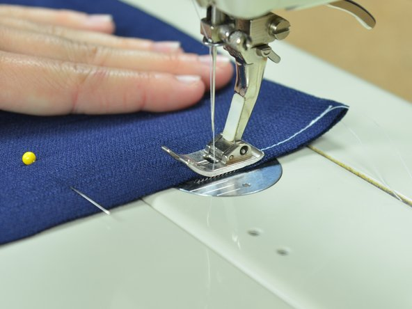 When guiding the fabric through a sewing machine you should not be pushing or pulling. The machine will feed the fabric in at the right speed. Your job is merely to guide the fabric so the seam remains straight.