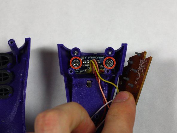 Remove the 2, #8 11.7 mm Phillips Head screws on the On/Off Switch Board