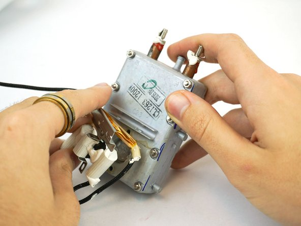 Pull apart wire connectors to fully detach the heating element.