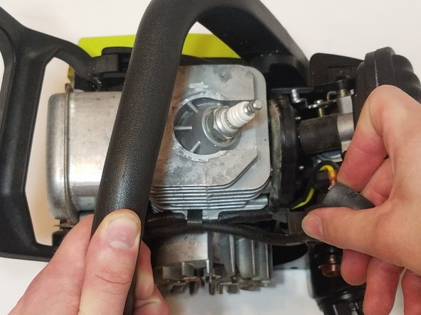 With the top cover off, disconnect the sparkplug