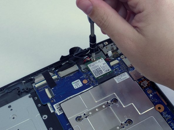 Remove the 3-mm screw that holds the WiFi module to the motherboard using the PH0 screwdriver.